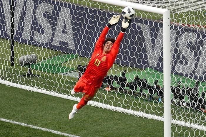 goalkeeper trying to catch the ball